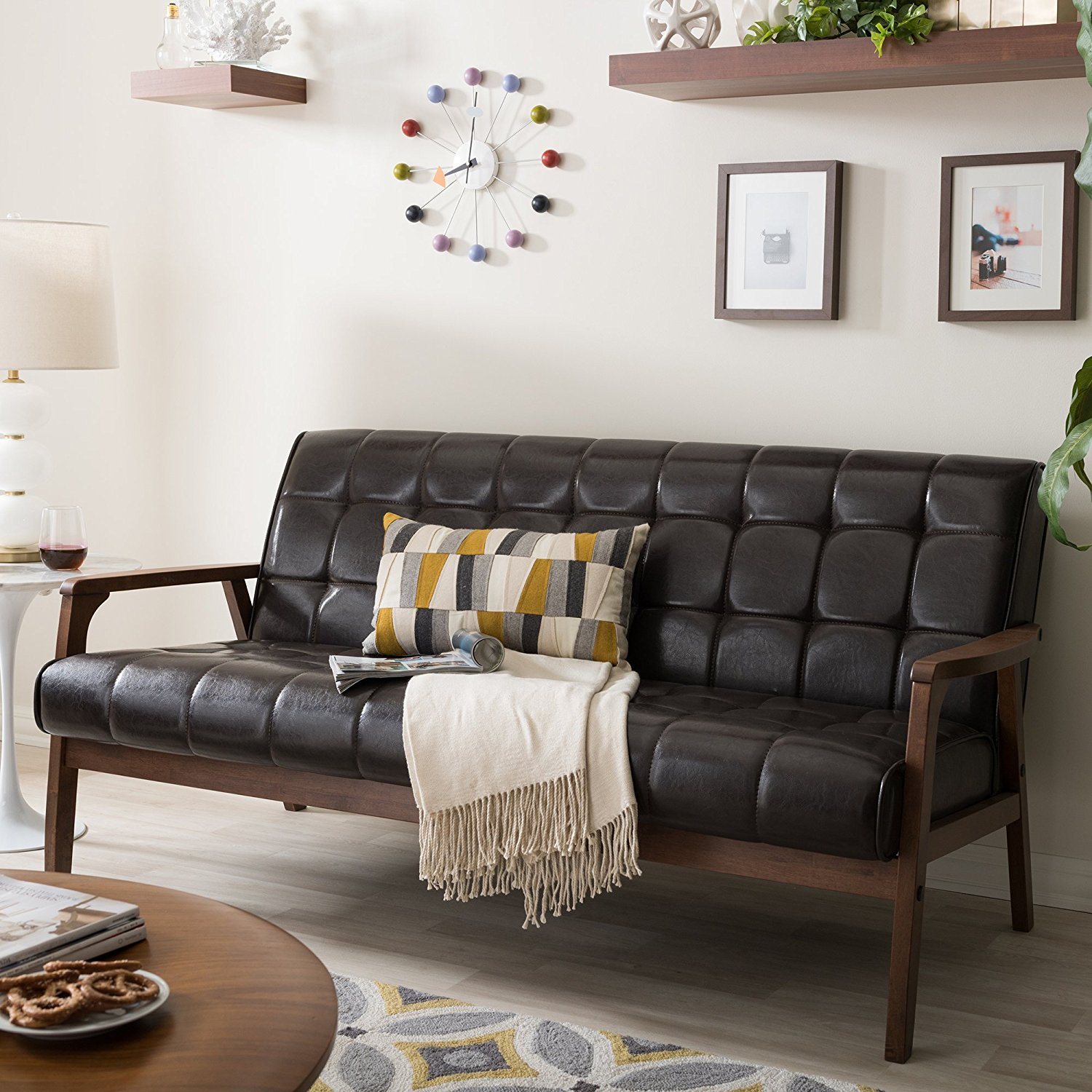 Baxton mid-century sofa is a great cheap leather sofa you can have in your home.