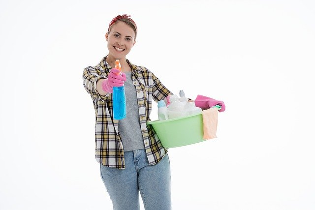lady with cleaning supplies